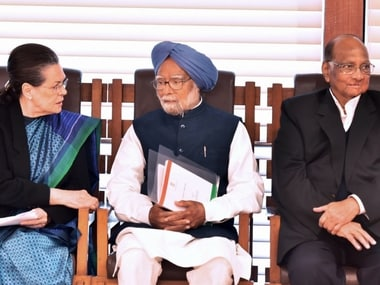 Sonia Gandhi speaks with former Prime Minister Dr Manmohan Singh as NCP President Sarad Pawar looks on during an all opposition parties meeting in New Delhi on Thursday. PTI