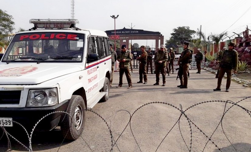 Security personnel takes positions at Sunjuwan Army camp in Jammu. Sameer Yasir