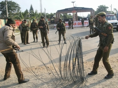 Security personnel place the barbed wires outside the Sunjwan Army camp, in Jammu on Saturday. PTI
