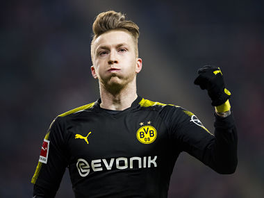Dortmund´s midfielder Marco Reus celebrates scoring during the German first division Bundesliga football match RB Leipzig vs Borussia Dortmund in Leipzig, eastern Germany, on March 3, 2018. / AFP PHOTO / ROBERT MICHAEL / RESTRICTIONS: DURING MATCH TIME: DFL RULES TO LIMIT THE ONLINE USAGE TO 15 PICTURES PER MATCH AND FORBID IMAGE SEQUENCES TO SIMULATE VIDEO. == RESTRICTED TO EDITORIAL USE == FOR FURTHER QUERIES PLEASE CONTACT DFL DIRECTLY AT + 49 69 650050