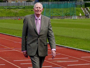 (FILES) In this file photo taken on May 6, 2004 Sir Roger Bannister walks on the track where 50 years ago he broke the four minute mile at Oxford University in Oxford, England. Record-breaking British athlete Roger Bannister, the first man to run a mile in under four minutes, has died aged 88, his family announced on Sunday, March 4, 2018. / AFP PHOTO / Carl DE SOUZA