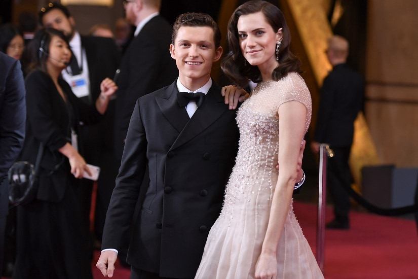 US actress Allison Williams (R) and British actor Tom Holland pose as they arrive for the 90th Annual Academy Awards on March 4, 2018, in Hollywood, California. / AFP PHOTO / ANGELA WEISS