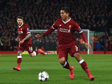 Liverpool's Brazilian midfielder Roberto Firmino controls the ball during the UEFA Champions League round of sixteen second leg football match between Liverpool and FC Porto at Anfield in Liverpool, north-west England on March 6, 2018. / AFP PHOTO / PAUL ELLIS