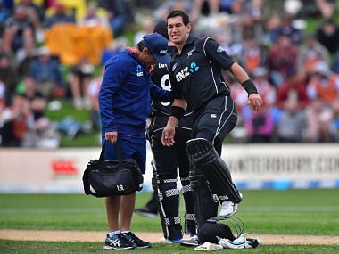 New Zealand's Ross Taylor lifts his injured leg during the fourth ODI cricket Test match between New Zealand and England at University Oval in Dunedin on March 7, 2018. / AFP PHOTO / Marty MELVILLE