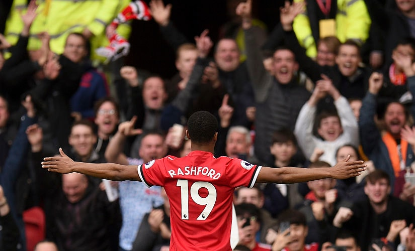 Manchester United's English midfielder Ashley Young celebrates scoring their second goal during the English Premier League football match between Manchester United and Liverpool at Old Trafford in Manchester, north west England, on March 10, 2018. / AFP PHOTO / Oli SCARFF / RESTRICTED TO EDITORIAL USE. No use with unauthorized audio, video, data, fixture lists, club/league logos or 'live' services. Online in-match use limited to 75 images, no video emulation. No use in betting, games or single club/league/player publications. /