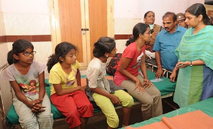 Theni district collector Pallavi Badev meets children, who survived the fire. Firstpost/Naveen Nair