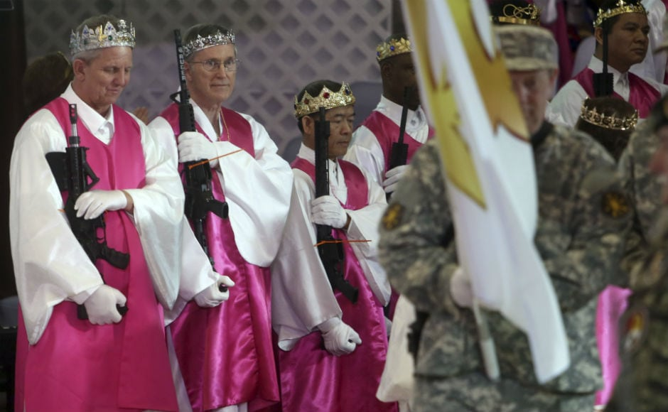 Dozens of US couples donned crowns and cradled guns at a controversial commitment ceremony in a Pennsylvania church on Wednesday. AP