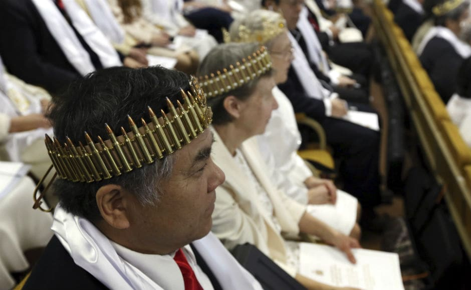 Some worshippers also wore crowns made out of bullets. Tim Elder, Unification Sanctuary's director of world missions, said the ceremony was meant to be a blessing of couples, not inanimate objects, calling the AR-15 a religious accouterment. AP