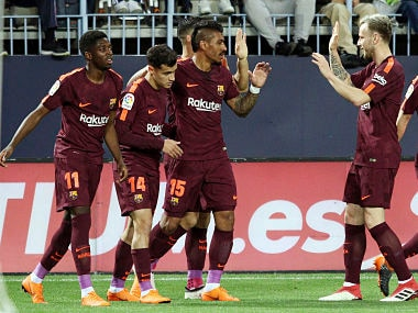 Barcelona's Coutinho celebrates with team mates scoring his side's 2nd goal during a Spanish La Liga soccer match between Malaga and Barcelona in Malaga, Spain, Saturday, March 10, 2018. (AP Photo/M.Pozo)