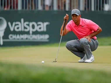 Tiger Woods lines up a putt on the 16th hole during the third round of the Valspar Championship golf tournament Saturday, March 10, 2018, in Palm Harbor, Fla. (AP Photo/Mike Carlson)
