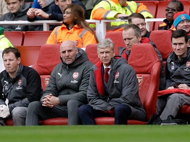 Arsenal French manager Arsene Wenger, center, sits on the bench during the English Premier League soccer match between Arsenal and Watford at the Emirates stadium in London, Sunday, March 11, 2018. (AP Photo/Matt Dunham)