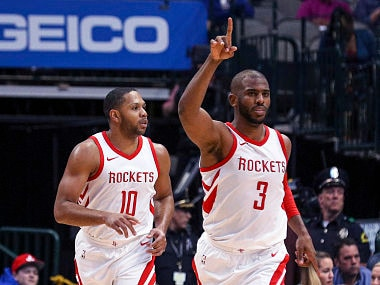 Houston Rockets guard Chris Paul (3) gestures after a basket guard Eric Gordon (10) in the second half of an NBA basketball game Sunday, March 11, 2018 in Dallas. (AP Photo/ Richard W. Rodriguez)