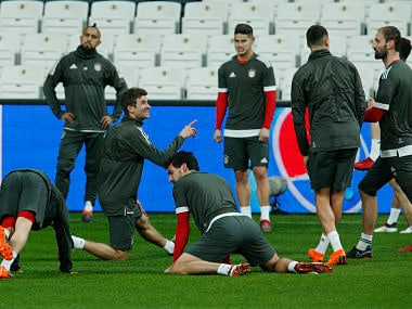 Bayern Munich's Thomas Mueller, centre, jokes with teammates during a training session in Istanbul, Tuesday, March 13, 2018, ahead of their team's Champions League round of 16 second leg soccer match against Besiktas Wednesday. (AP Photo/Lefteris Pitarakis)