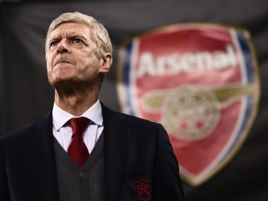 Arsene Wenger looks on during Arsenal's Europa League match against AC Milan. AFP