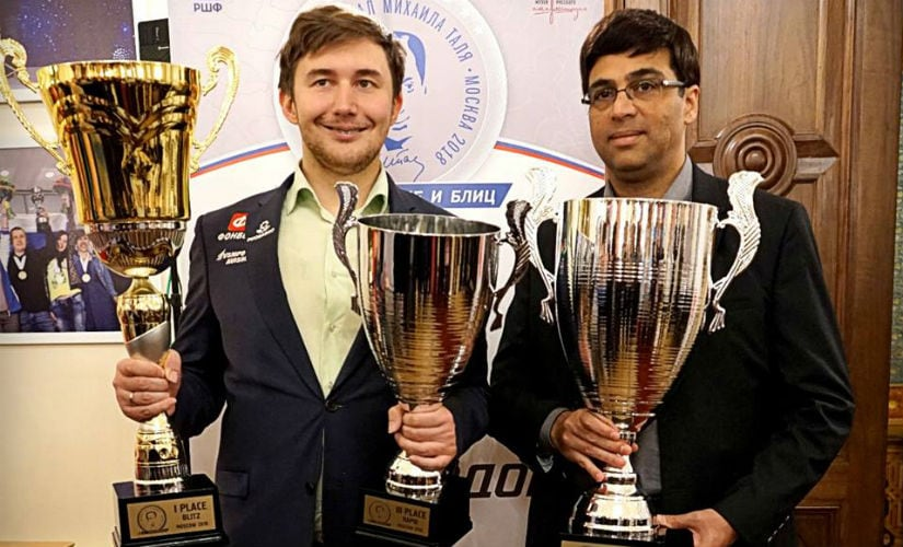 Sergey Karjakin and Viswanathan Anand with their trophies from the Rapid and Blitz events. Image Courtesy: Amruta Mokal
