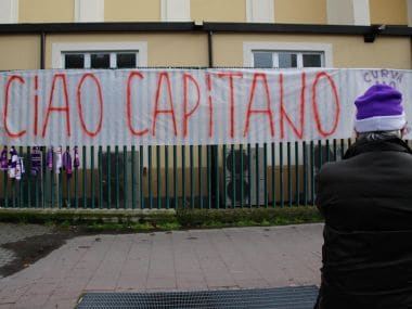"""A banner reading in Italian """"So long captain"""" is hung outside the Artemio Franchi stadium to honor Davide Astori. AP"""
