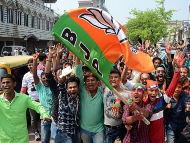 BJP supporters celebrate the party's win in Tripura. PTI