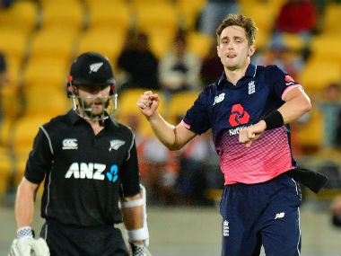 Kane Williamson wears a dejected look as Chris Woakes celebrates England's win in the third ODI. AFP