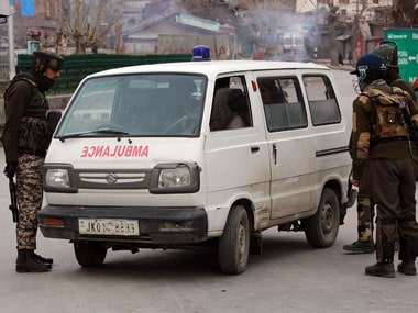 Paramilitary soldiers stop an ambulance for checking in old town area of Srinagar. Firstpost/Faisal Khan