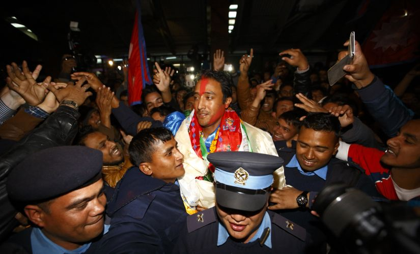 Captain of Nepali national cricket team Paras Khadka (C) is given a hero's welcome by Nepali supporters upon the team's arrival at the airport after qualifying for the 2014 ICC World Twenty20 cricket. Reuters