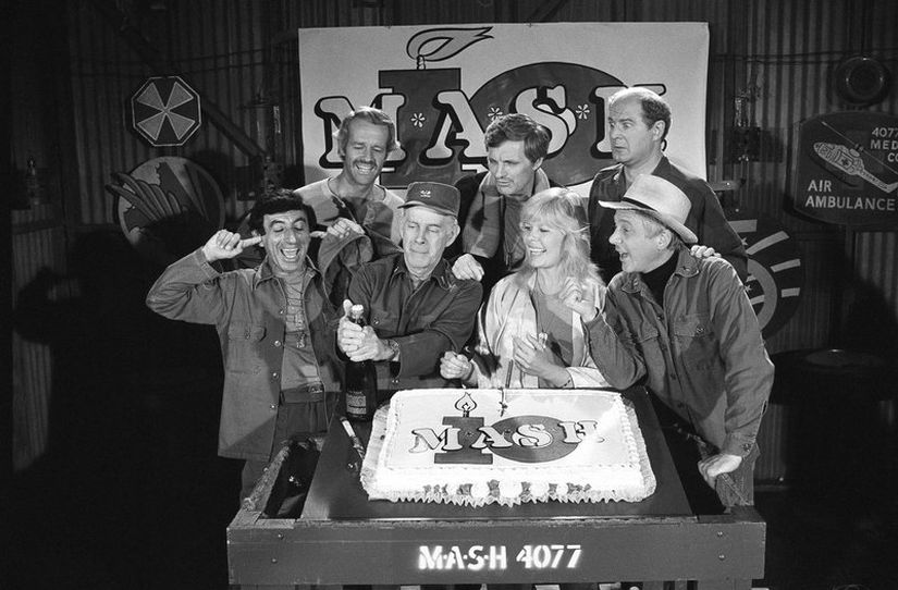 Back row (extreme right): David Ogden Stiers and MASH cast members celebrate during a party on the set of the popular CBS program in Los Angeles. AP