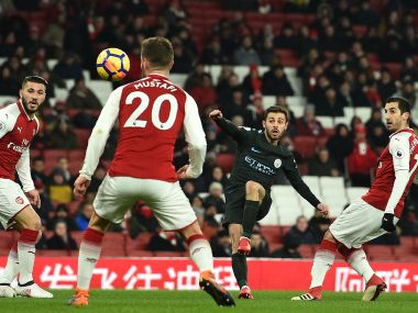 Manchester City's Portuguese midfielder Bernardo Silva (2nd R) scores the opening goal against Arsenal on 1 March, 2018. AFP