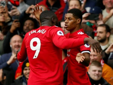 Marcus Rashford celebrates with Romelu Lukako after scoring against Liverpool. Reuters