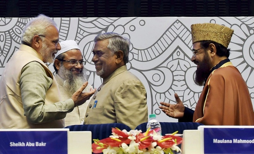 "Prime Minister Narendra Modi interacts with Islamic scholar Akhtarul Wasey, Maulana Mahmood Madani and Shahi Imam Mufti Mukarram (right) of Fatehpuri Mosque at the conference on ""Islamic Heritage: Promoting Understanding and Moderation"". PTI"