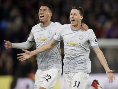 Manchester United's Nemanja Matic, right, celebrates after scoring against Crystal Palace. AP