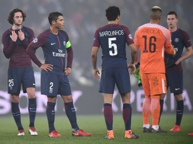 Paris Saint-Germain's players react after losing in the Champions League round of 16 second leg. AFP