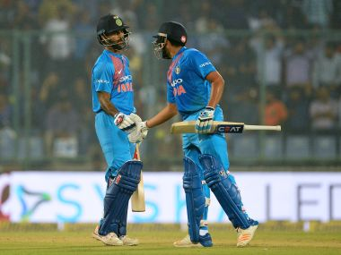 Indian batsman Shikhar Dhawan (L) is greeted by teammate Rohit Sharma after scoring a half century (50 runs) during the first T20 cricket match between New Zealand and India at Feroz Shah Kotla Cricket Stadium in New Delhi on November 1, 2017. / AFP PHOTO / SAJJAD HUSSAIN / ----IMAGE RESTRICTED TO EDITORIAL USE - STRICTLY NO COMMERCIAL USE----- / GETTYOUT