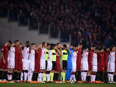 Players look on during a tribute to Davide Astori during the Serie A match between Roma and Torino. AFP