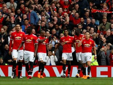 Manchester United players celebrate Marcus Rashfords' goal against Liverpool. Reuters