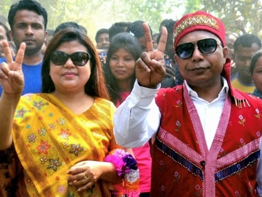 Meghalaya Chief Minister and Congress candidate Mukul Sangma along with his wife Dikkanchi D Shira flash victory sign after they won their constituencies in the Meghalaya Assembly elections, at Ampati. PTI