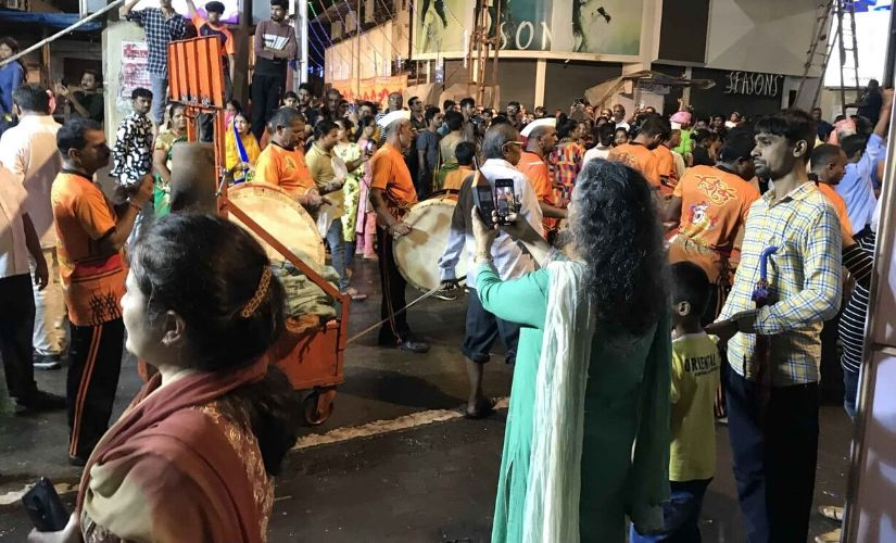 Mumbai anti-noise activist Sumaira Abdulali checks the sound levels of a procession on the final night of the 10-day Ganesh festival, when thousands of idols are led by drums and other music down to the sea for ceremonial immersion. Photo credit: Chris Berdik.