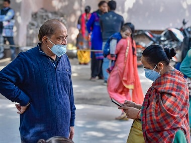 People wearing protective masks in the wake of novel coronavirus or COVID-19 outbreak, stand outside RML Hospital in New Delhi. PTI