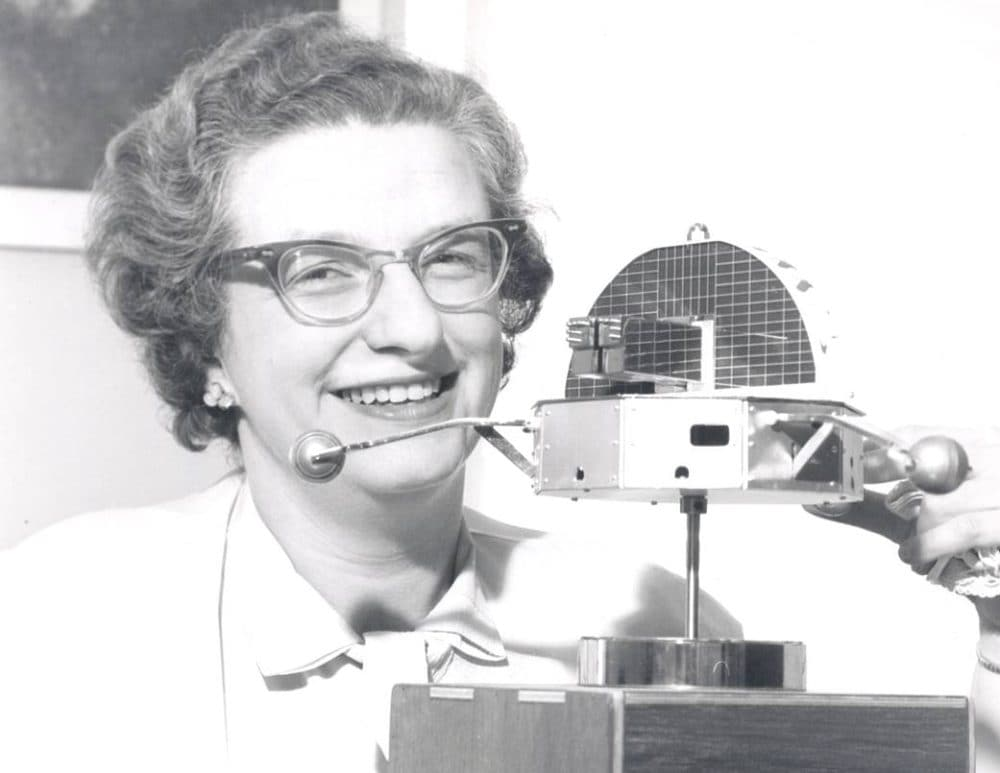 Dr. Nancy Grace Roman is shown with a model of the Orbiting Solar Observatory in 1962. She was the first Chief of Astronomy in the Office of Space Science at NASA Headquarters. Image credit NASA