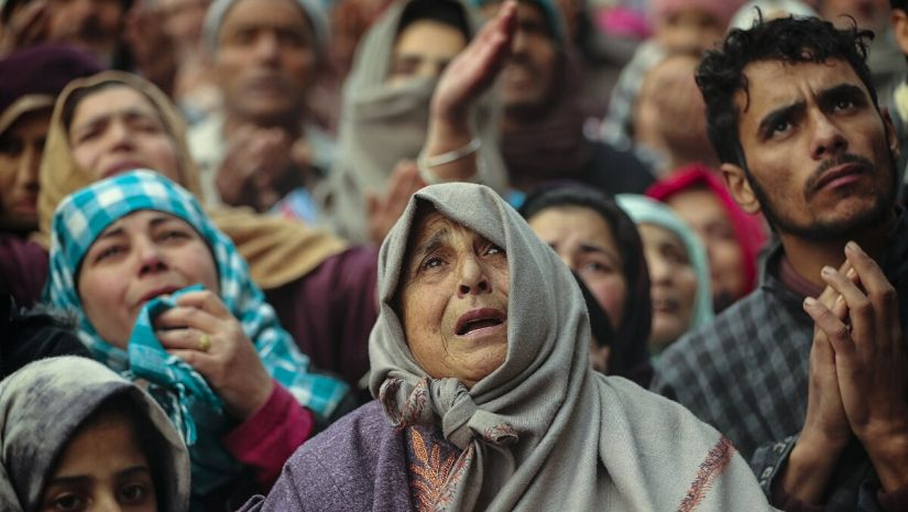 Kashmiri Muslim devotees offer prayer outside the shrine of Sufi saint Sheikh Syed Abdul Qadir Jeelani in Srinagar, Indian controlled Kashmir, Dec. 9, 2019. Hundreds of devotees gathered at the shrine for the 11-day festival that marks the death anniversary of the Sufi saint. The image was part of a series of photographs by Associated Press photographers which won the 2020 Pulitzer Prize for Feature Photography. Image via The Associated Press/ Mukhtar Khan