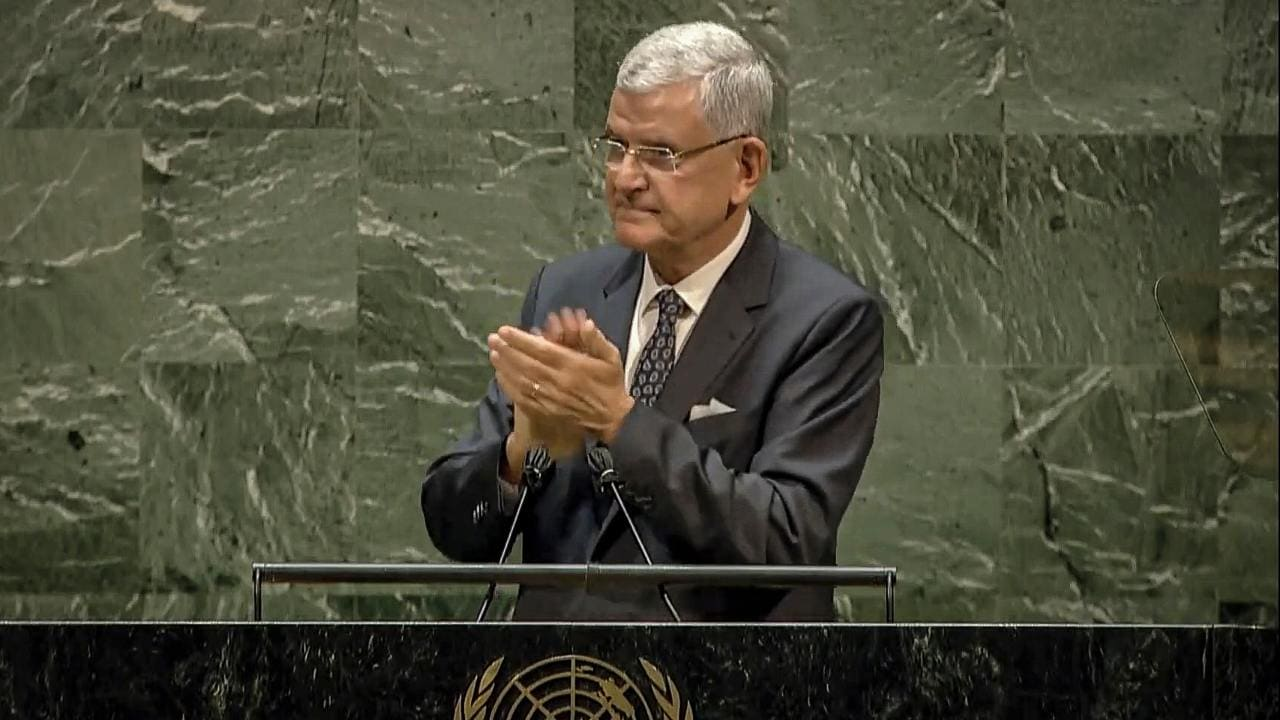 In this UNTV image, Volkan Bozkir, President of the 75th session of the United Nations General Assembly, applaud as he delivers closing remarks, Tuesday, Sept. 29, 2020, at UN headquarters in New York. (UNTV via AP)