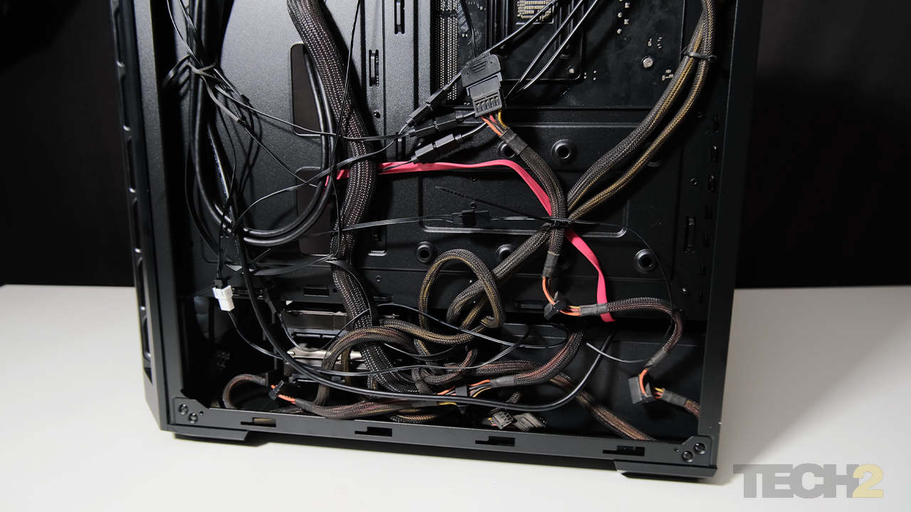 """5.If you have a relatively large PSU and you use the 3.5"""" drive bays, you're going to struggle a bit with stashing away excess cable. Image: Anirudh Regidi"""