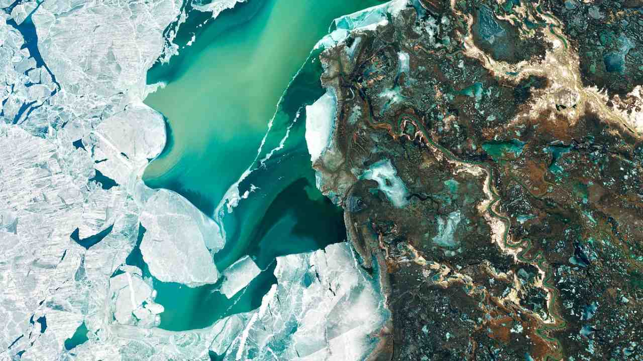Seen from space, the icy Ili River Delta contrasts sharply with the beige expansive deserts of southeastern Kazakhstan. On 7 March 2020, the Landsat 8 acquired this natural-colour image of the delta was just starting to shake off the chill of winter. While many of the delta's lakes and ponds were still frozen, the ice on Lake Balkhash was breaking up, revealing swirls of sediment and the shallow, sandy bed of the western part of the lake. Image Credits: NASA Earth Observatory images by Joshua Stevens, using Landsat data from the U.S. Geological Survey