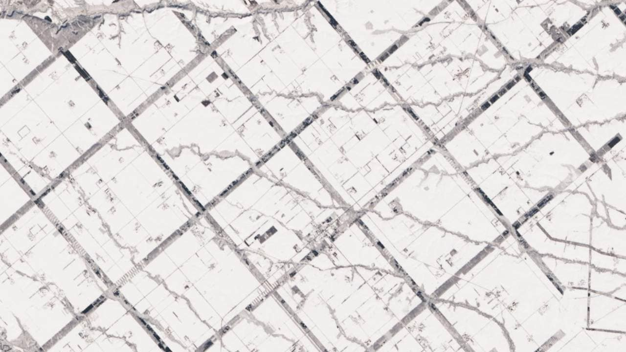From above, the Konsen Plateau in eastern Hokkaido offers a remarkable sight: a massive grid that spreads across the rural landscape like a checkerboard, visible even under a blanket of snow. Photographed by the Landsat 8, this man-made design is not only aesthetically pleasing, but it's also an agricultural insulator. The strips are forested windbreaks—180-meter wide rows of coniferous trees that help shelter grasslands and animals from Hokkaido's sometimes harsh weather. In addition to blocking winds and blowing snow during frigid, foggy winters, they help prevent winds from scattering soil and manure during the warmer months in this major dairy farming region of Japan. Image credits: NASA Earth Observatory images by Lauren Dauphin