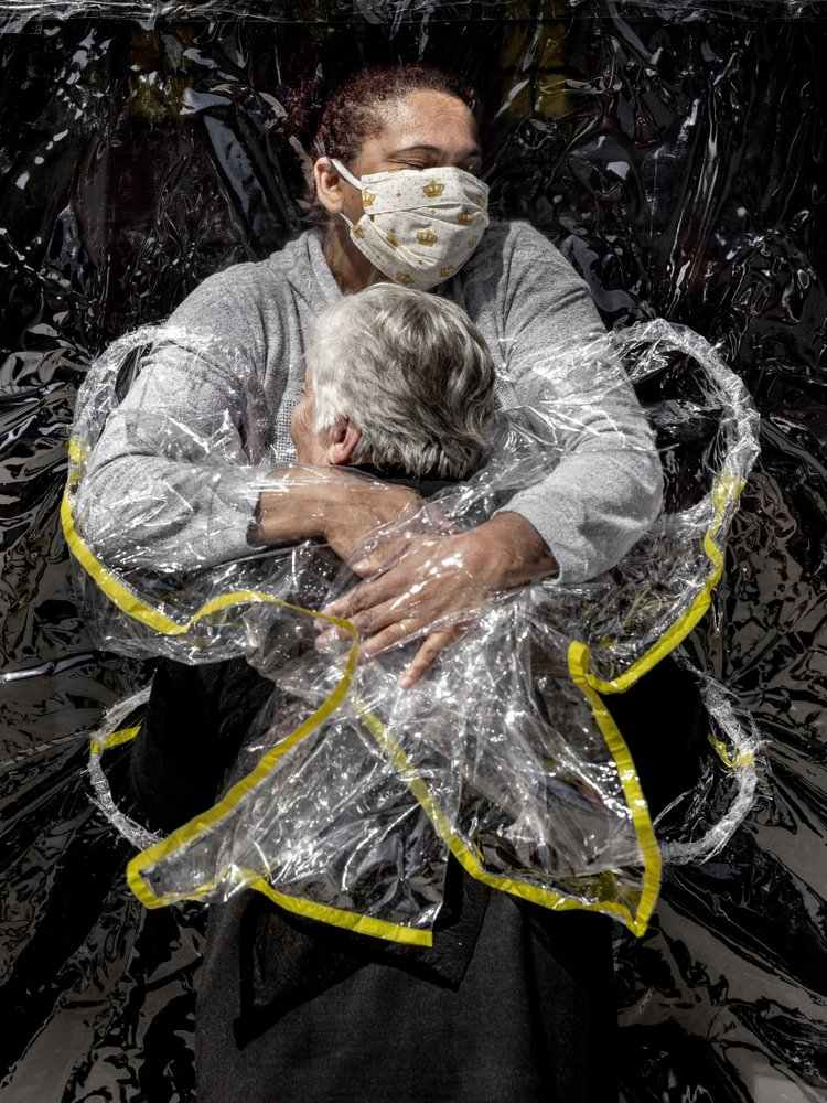 Nurse embracing patient in Brazil wearing hug curtain wins World Press Photo of the Year