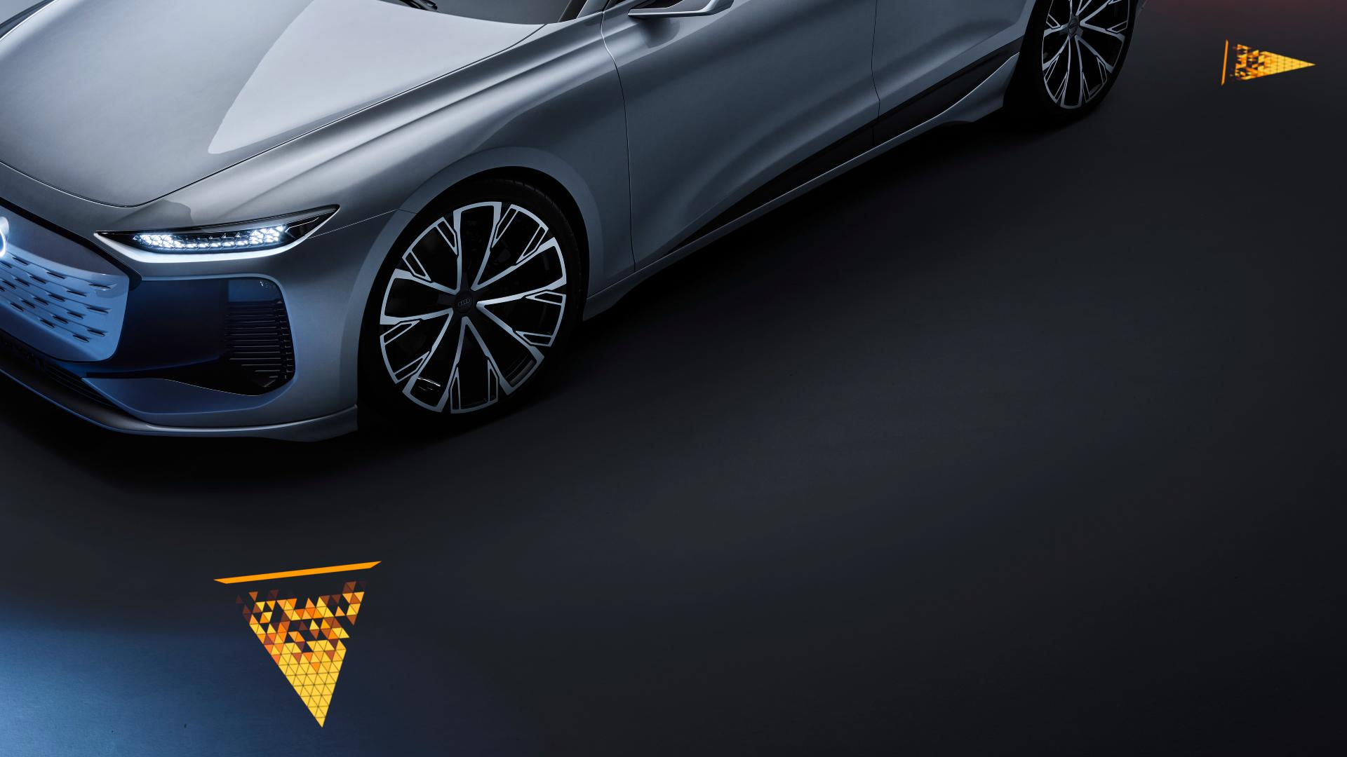 The Audi A6 e-tron concept's Matrix LED headlights can project vital signs onto the road surface. Image: Audi