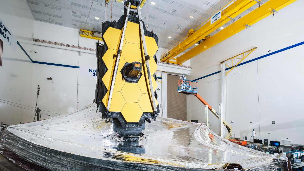 The James Webb telescope will fly to space folded like a piece of origami artwork, which allows it to fit inside a five-meter rocket fairing. Image credit: Flickr/NASA/Chris Gunn