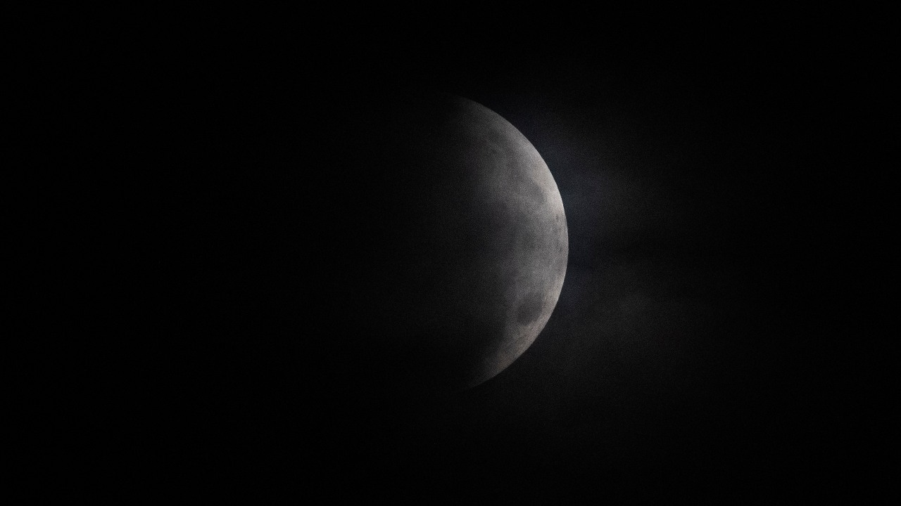 A lunar eclipse or a Chandra Grahan occurs when the moon moves into the Earth's shadow and light from the Sun cannot fall on the moon. The moon is partially covered during a lunar eclipse over Mexico City, early Wednesday, May 26, 2021. (AP Photo/Marco Ugarte)