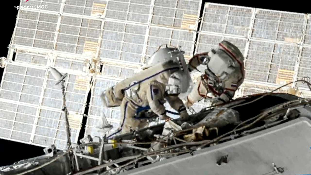 In this image taken from Roscosmos video, Russian cosmonauts Oleg Novitsky, left, and Pyotr Dubrov, members of the crew to the International Space Station (ISS), perform their first spacewalk on Wednesday, June 2, 2021, to replace old batteries outside the International Space Station. Two Russian members of the International Space Station crew are conducting a spacewalk. Image credit: Roscosmos via AP