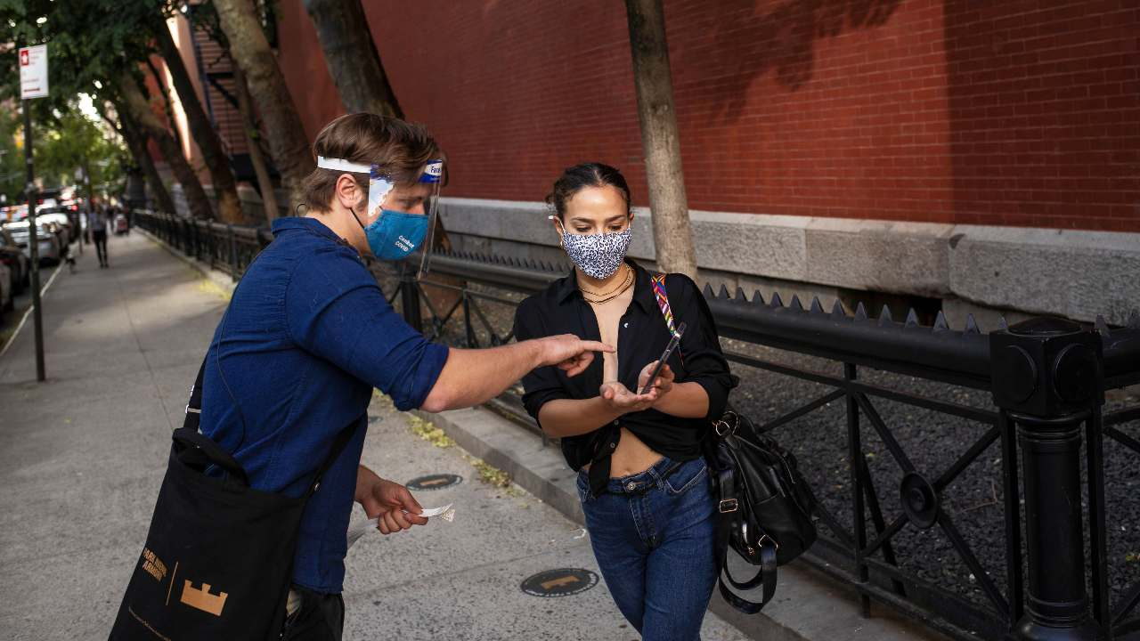 women shows proof of her COVID-19 vaccination on her phone before a performance at the Park Avenue Armory in Brooklyn, May 25, 2021. New Yorkers can download an app that they can use to show proof of their vaccination: the Excelsior Pass, which was introduced in March as the first and only government-issued vaccine passport in the country, accessible, for now, only to people who have been vaccinated in the state. Image credit: Victor J. Blue/The New York Times