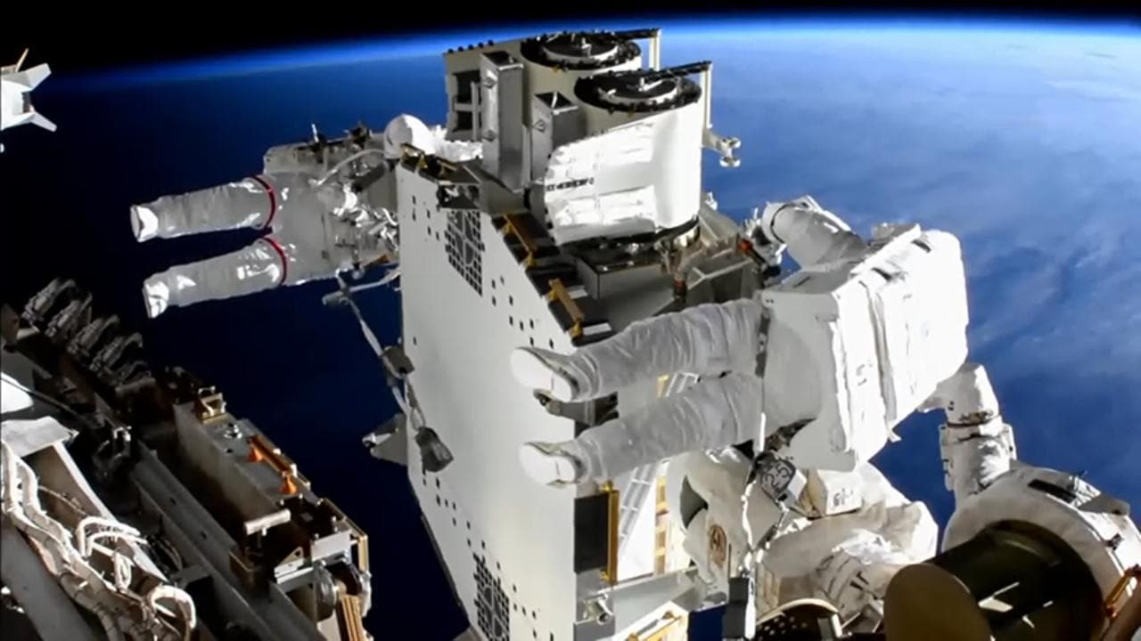 Spacewalkers Shane Kimbrough (foreground) and Thomas Pesquet work to prepare the second roll out solar array ready for installation an upcoming spacewalk. Image credit: NASA