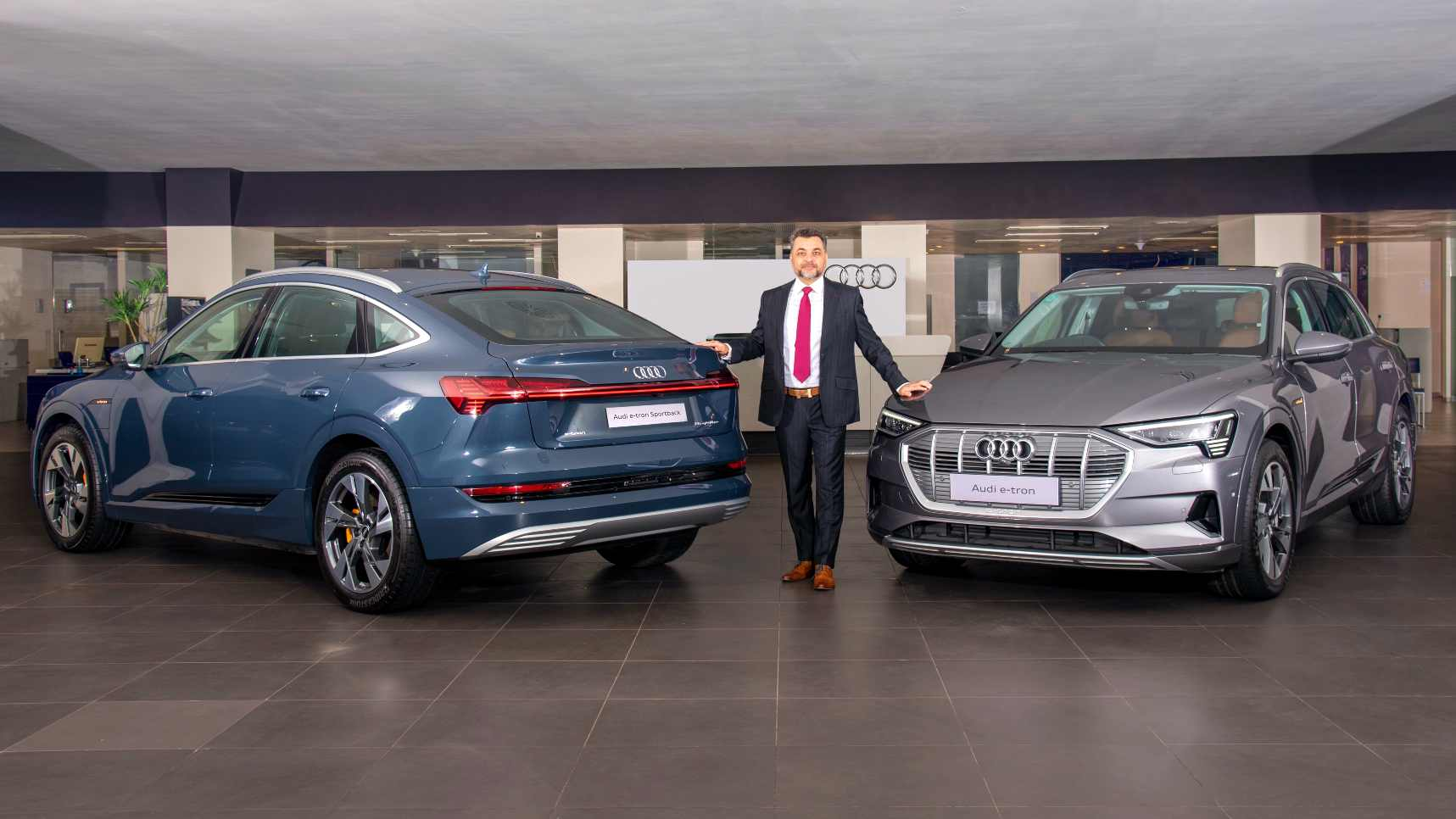 The Audi e-tron Sportback (left) costs roughly Rs 1.5 lakh more than the standard e-tron 55. Image: Audi India